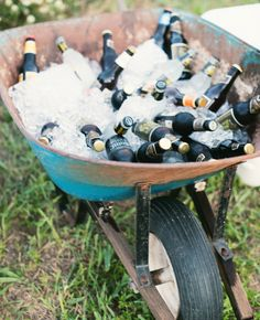 beers on ice in wheelbarrow