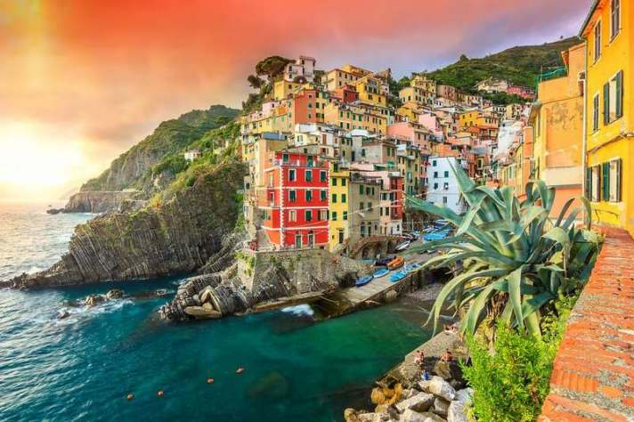 Panorama of Riomaggiore and wonderful sunset,Cinque Terre National Park,Liguria,Italy,Europe